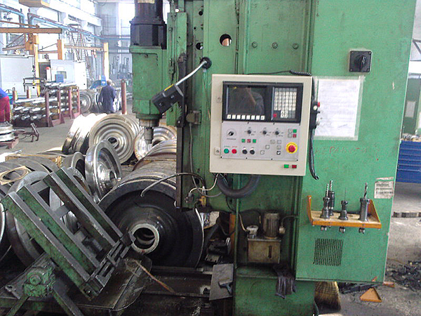 Machine for producing of wagon wheels